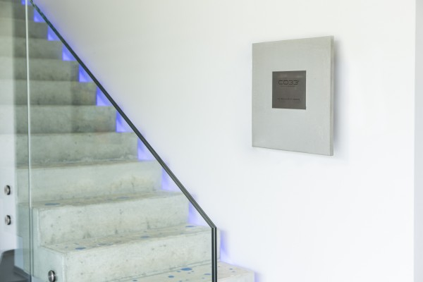 Concrete artwork with stainless steel engraving plate
