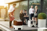 Terrace scene with friends grilling using OPUS IGNIS Firebowl with grill